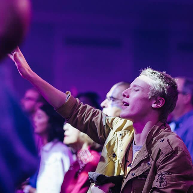 raising hands in worship